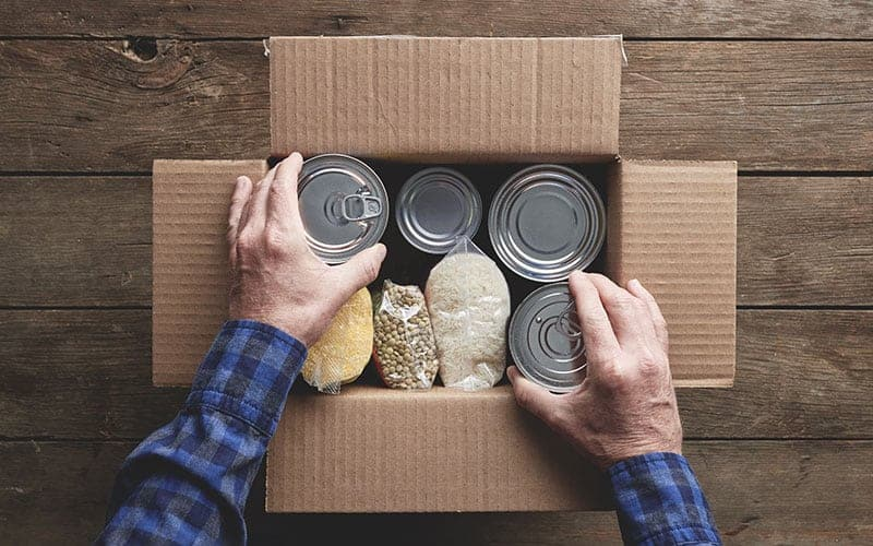 SIMM Associates employees collect canned foods for local branch of the Food Bank of Delaware